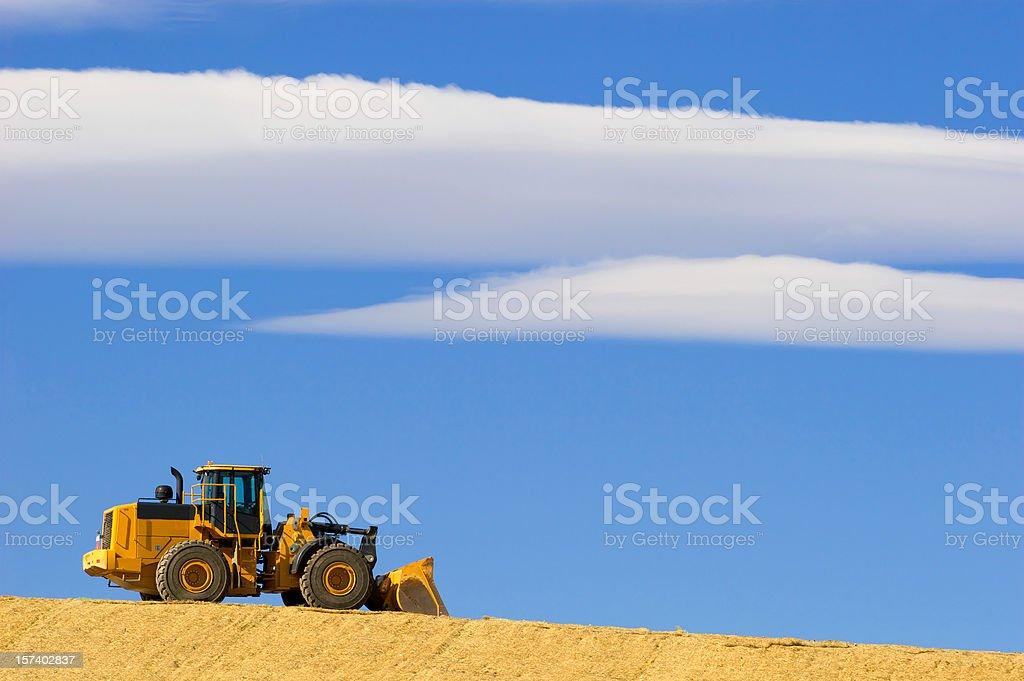 Bulldozer on the horizon royalty-free stock photo