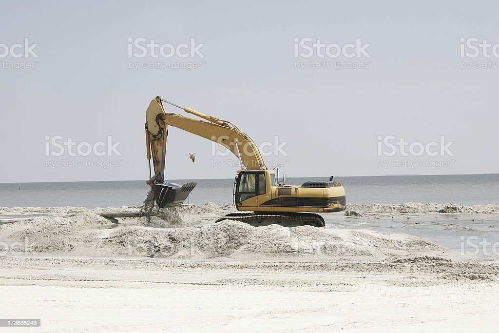 Bulldozer Rebuilds Sandy Beach after Katrina royalty-free stock photo