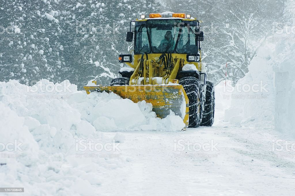 bulldozer removing snow stock photo