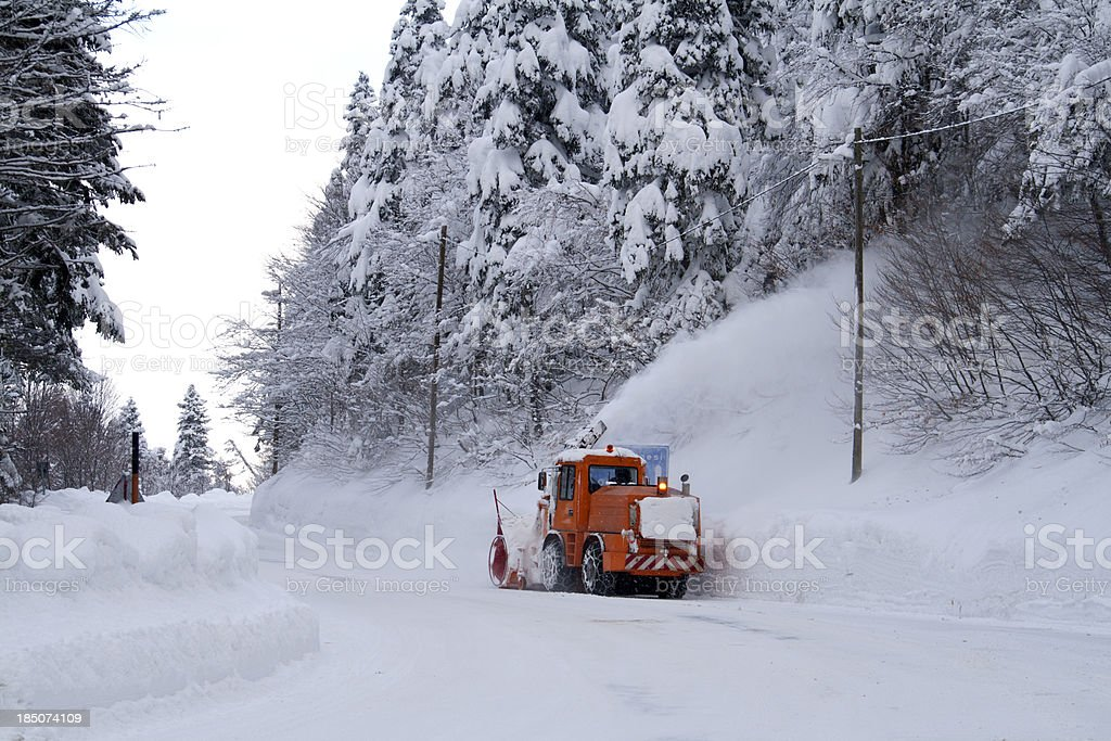 bulldozer removing snow royalty-free stock photo