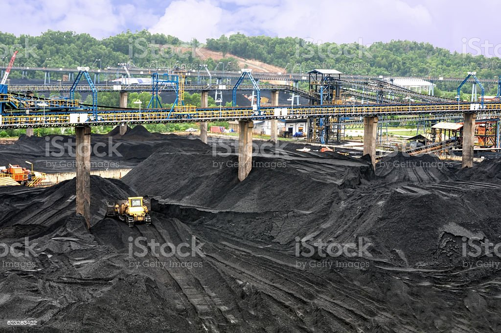 bulldozer was making a pile of coal stock photo