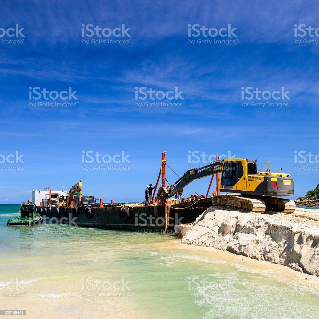 bulldozer working on a beach stock photo
