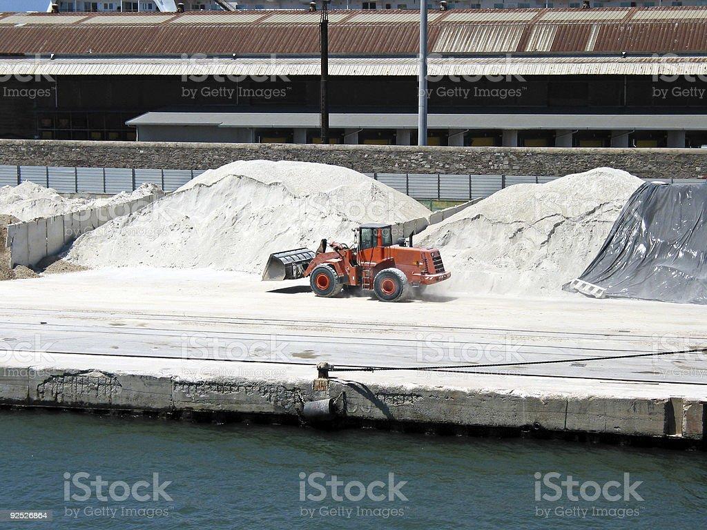 Bulldozer working on harbor royalty-free stock photo