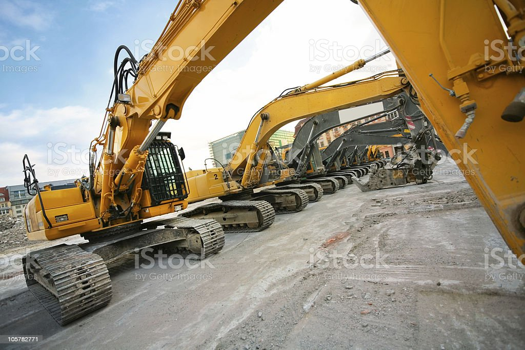 bulldozers in a row royalty-free stock photo
