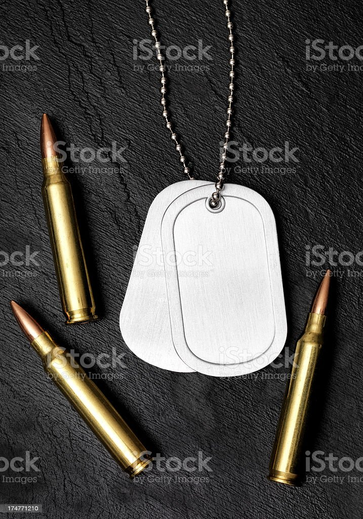 Bullet and Dog Tag royalty-free stock photo