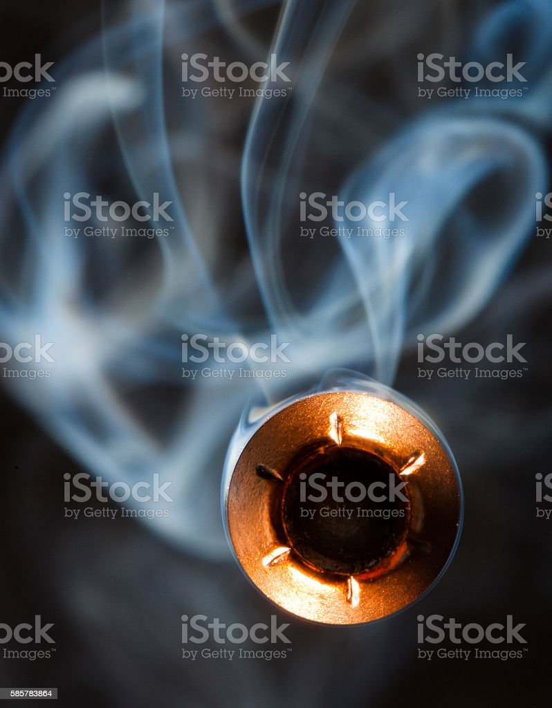 Bullet and smoke stock photo