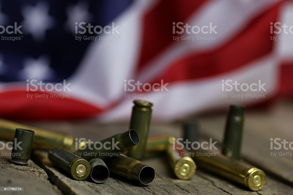 bullet and usa flag in the sand war stock photo