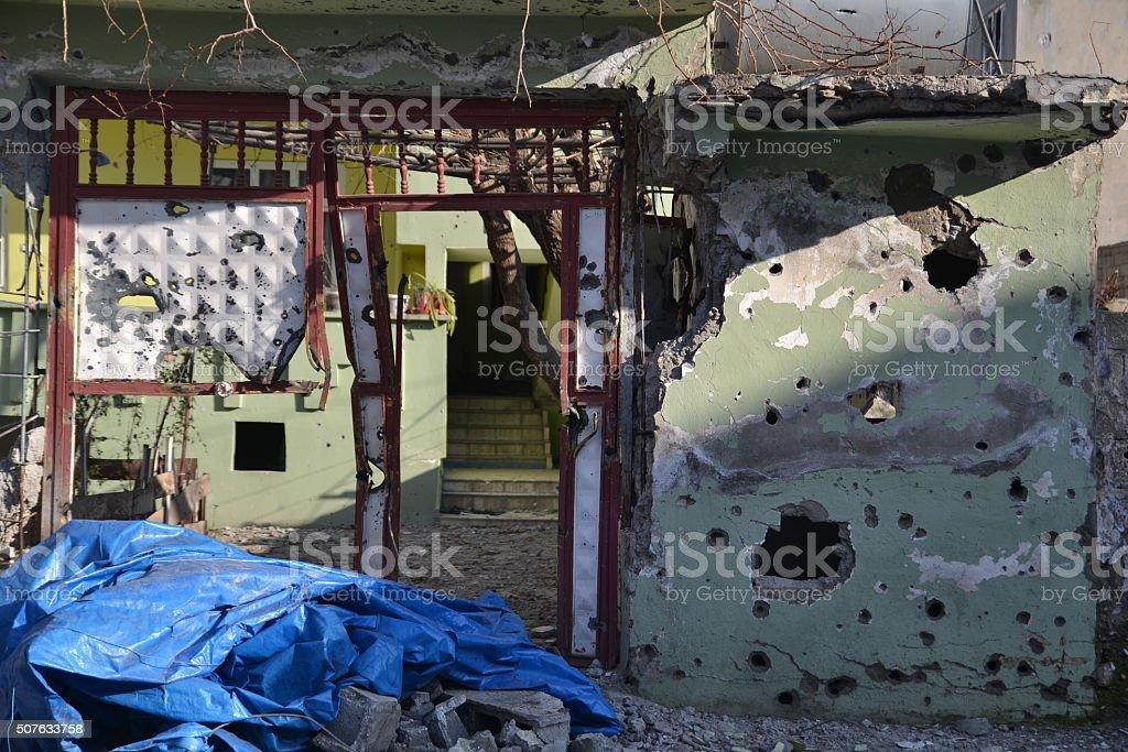 Bullet bomb damaged wall stock photo