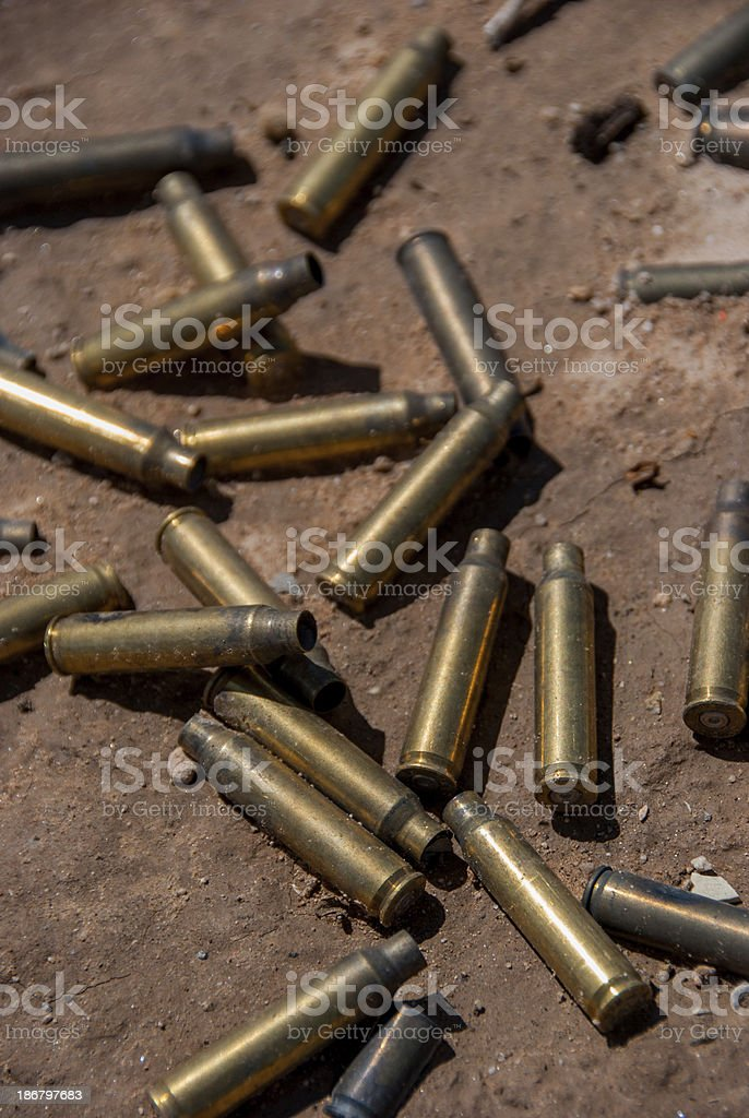 Bullet Casings in Dirt royalty-free stock photo