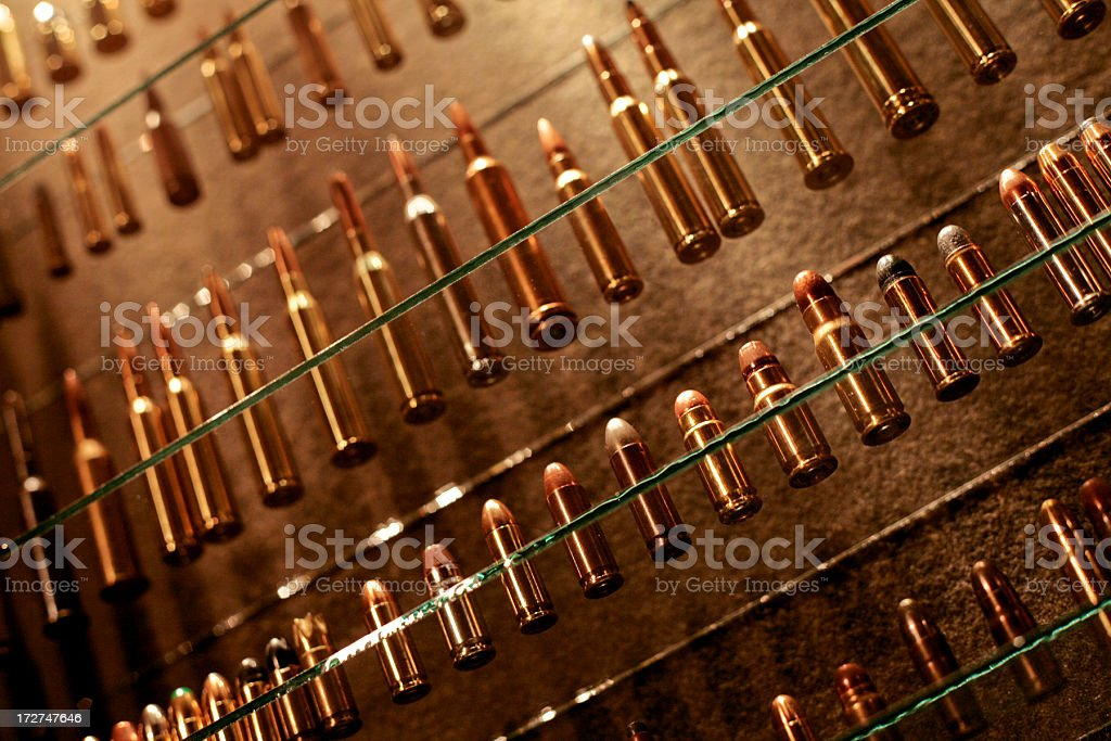 Bullet Collection on Glass Shelves royalty-free stock photo