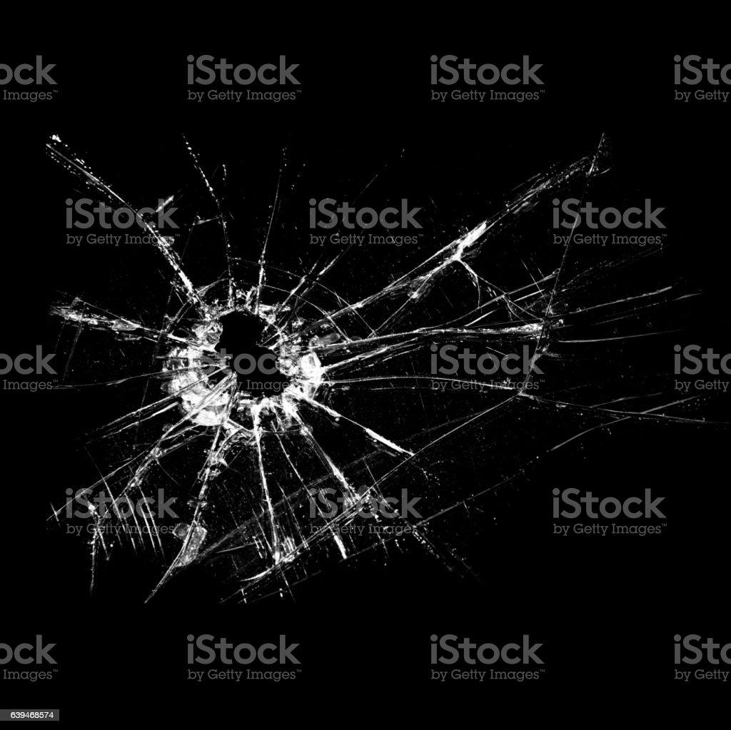 Bullet hole -broken glass on a black background stock photo