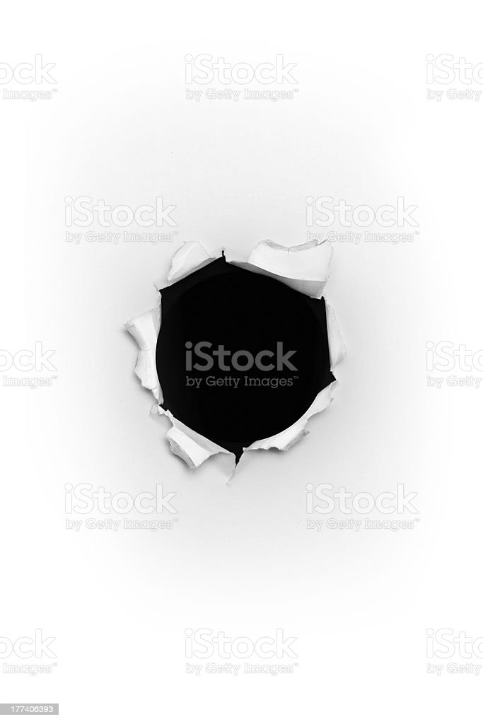 Bullet hole in paper stock photo