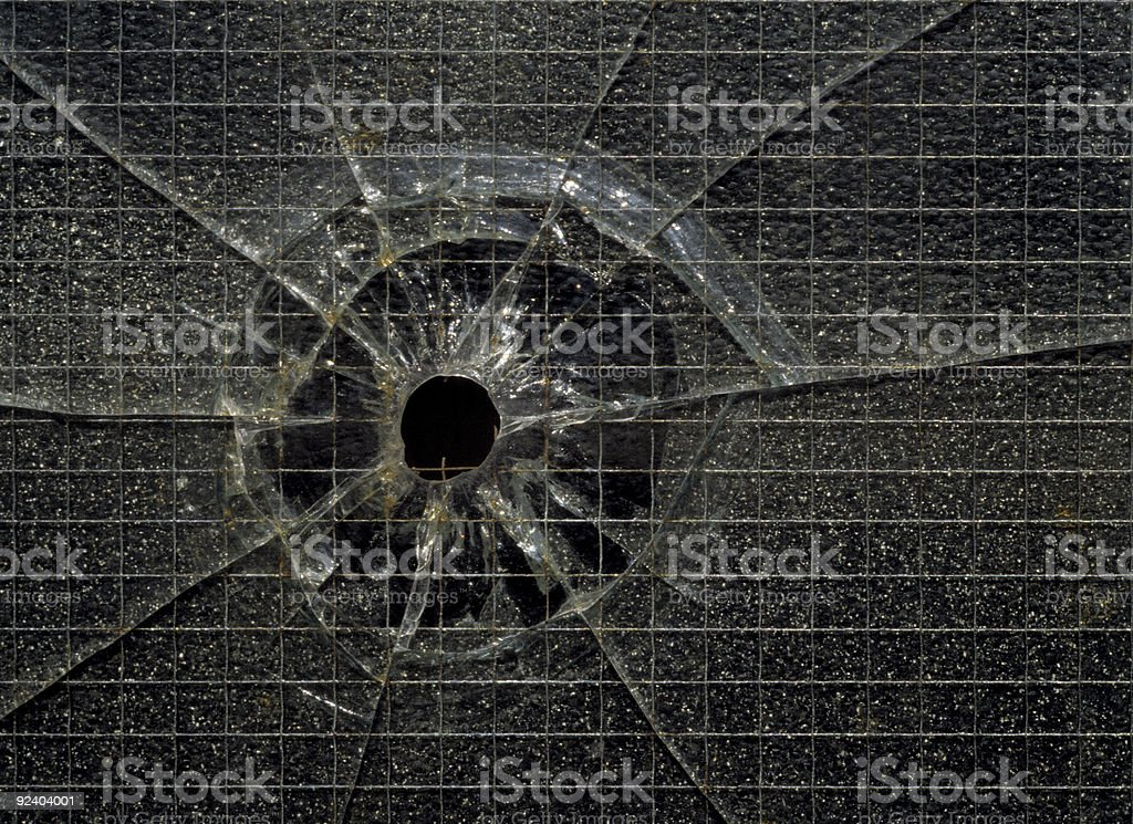 Bullet hole through glass royalty-free stock photo