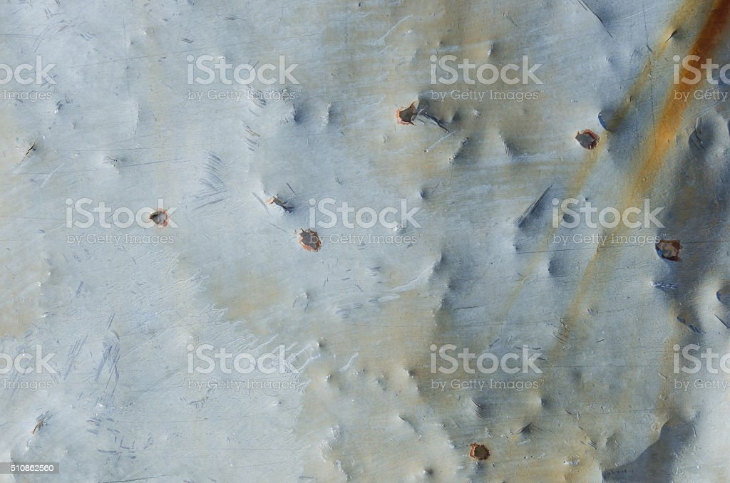 Bullet Holes in Aged Sheet Metal stock photo