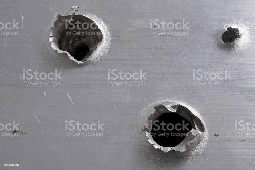 Bullet Holes in Aluminum stock photo