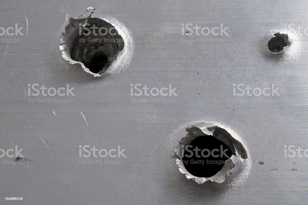 Bullet Holes in Aluminum stock photo