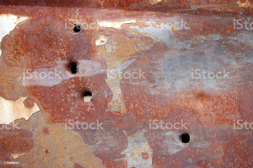 bullet holes in rusty car panel stock photo