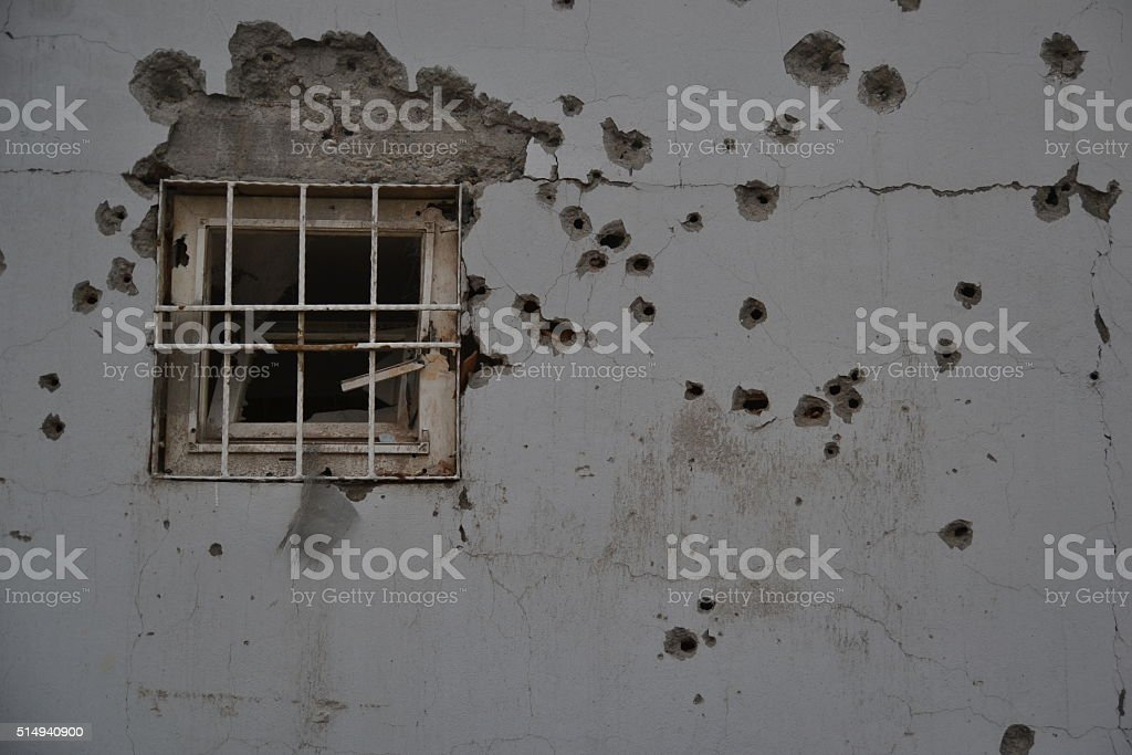 Bullet Holes on wall with a Window stock photo