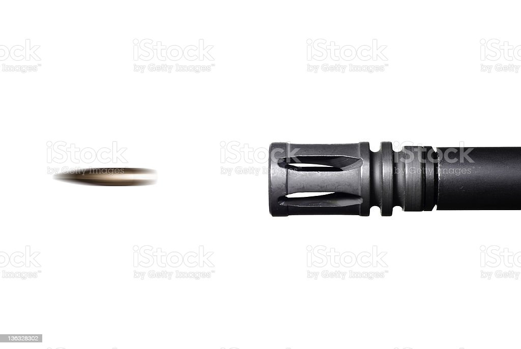 Bullet leaving the barrel of an AR-15 rifle. royalty-free stock photo
