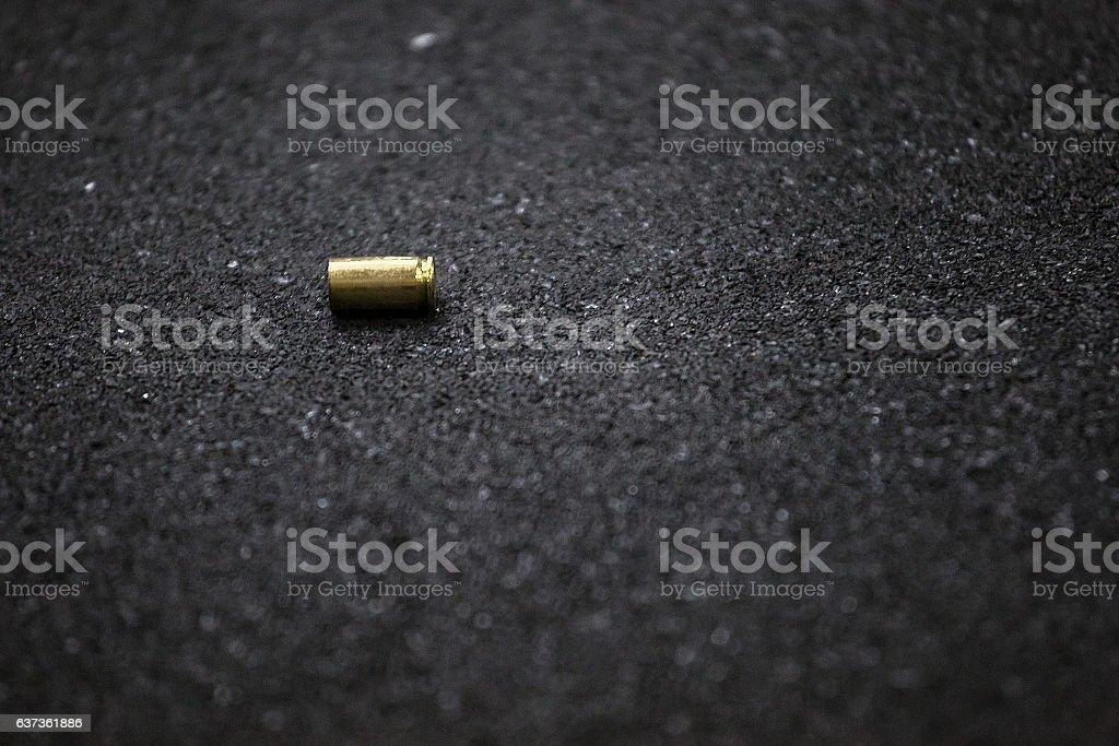 bullet shell ground stock photo