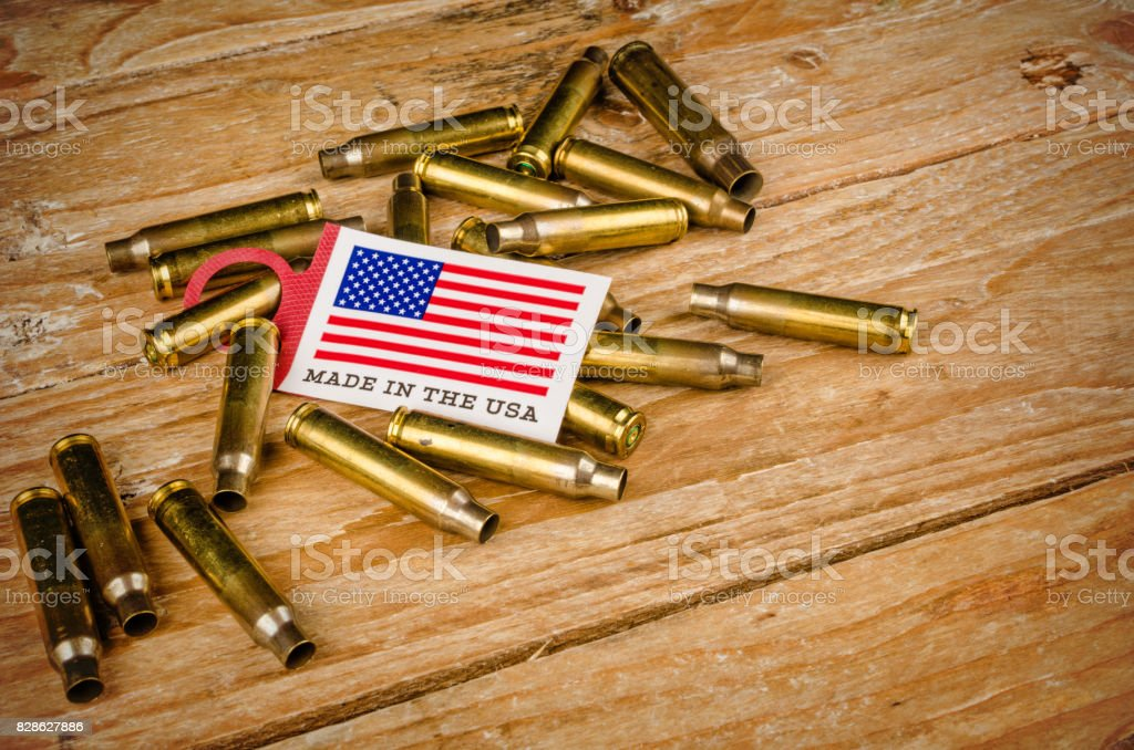 Bullet shells and US flag stock photo