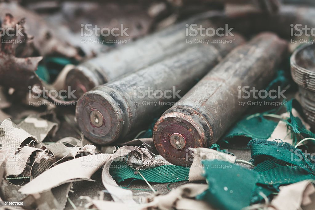 bullet shells from heavy machine gun on the table stock photo
