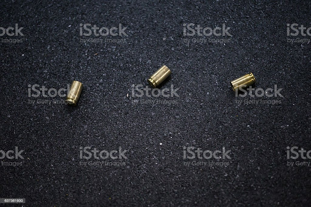 bullet shells ground stock photo