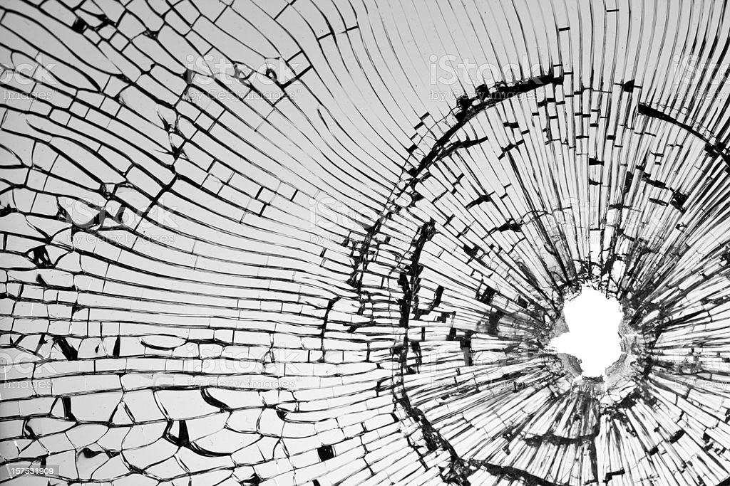 Bullet shot on broken window stock photo