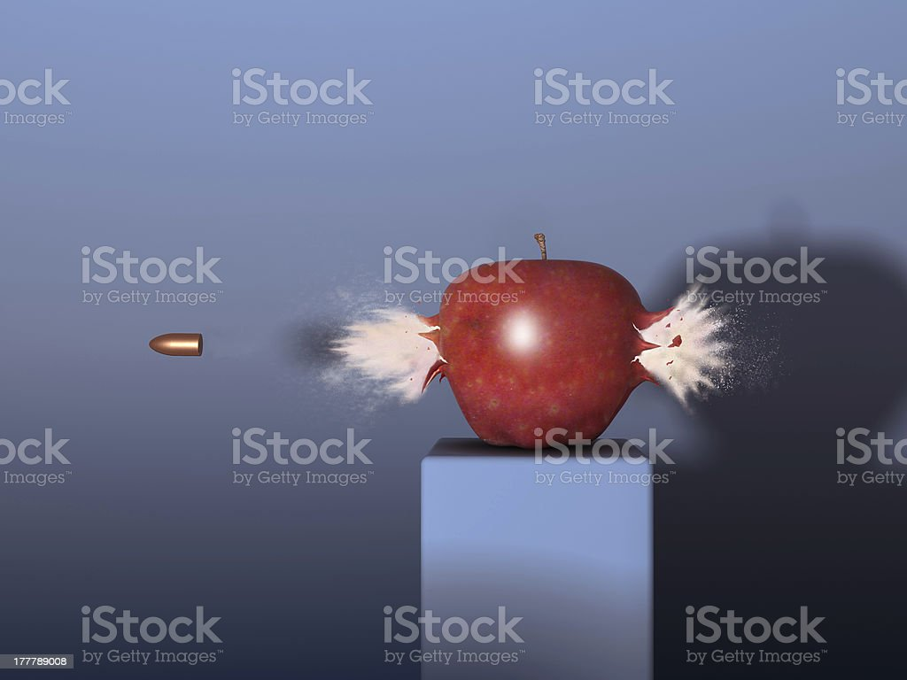 Bullet through an apple stock photo
