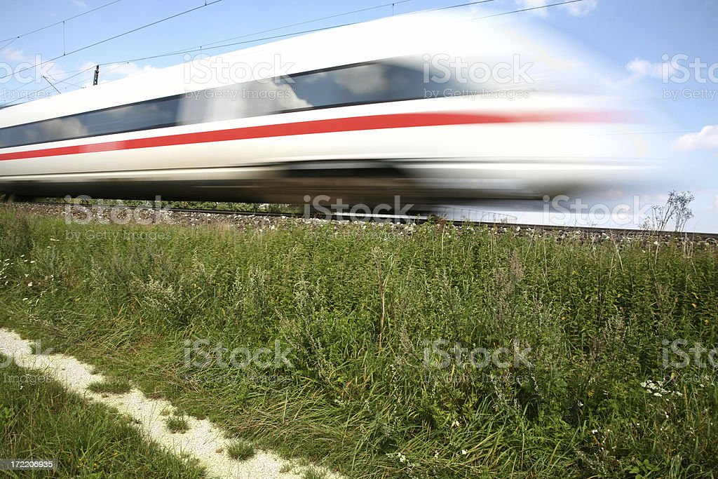 Bullet train breezing down the tracks stock photo