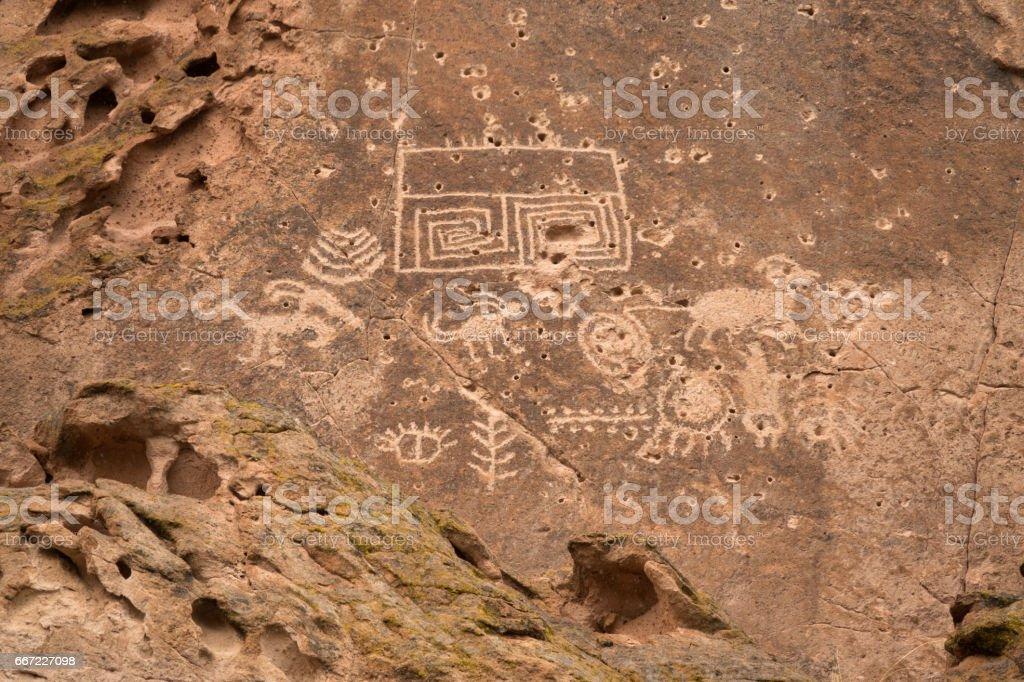Bullet vandalism petroglyph rock art panel Fremont Indian State Park Utah stock photo