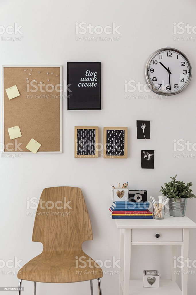 Bulletin board and wooden chair stock photo