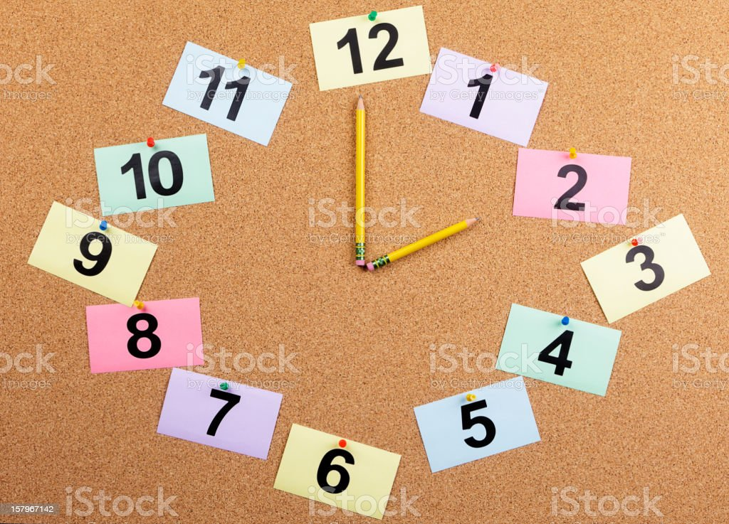 Bulletin Board Clock Displaying 2:00 stock photo