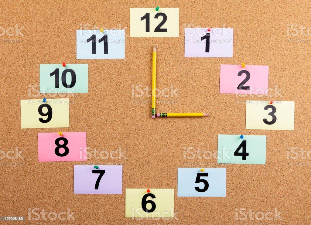Bulletin Board Clock Displaying 3:00 stock photo