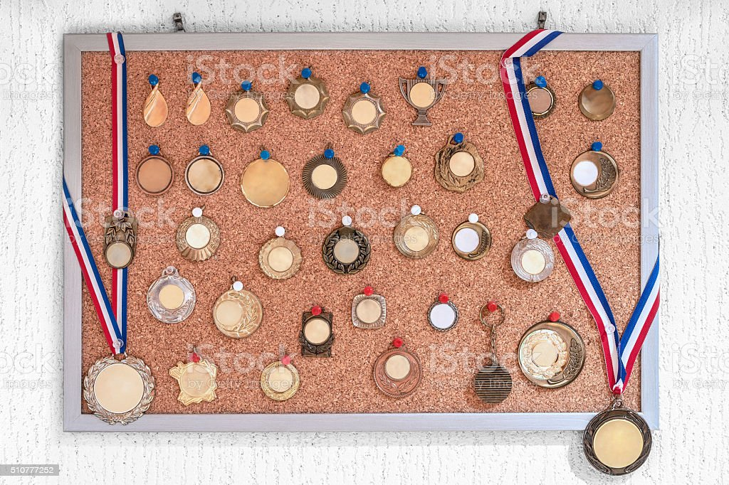 Bulletin board of collection of multiple blank medals front view stock photo