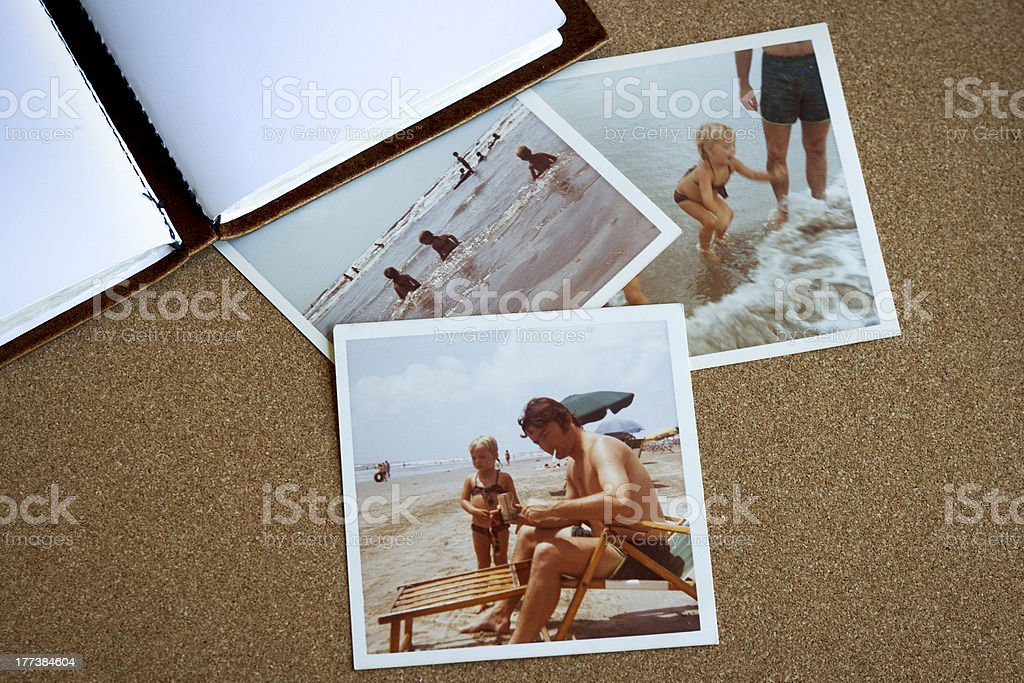 Bulletin board with 1970s family photos at beach stock photo