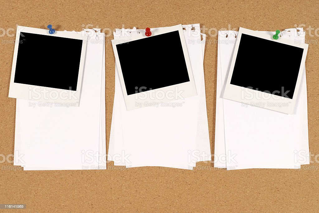 Bulletin board with blank photographs and blank paper stock photo