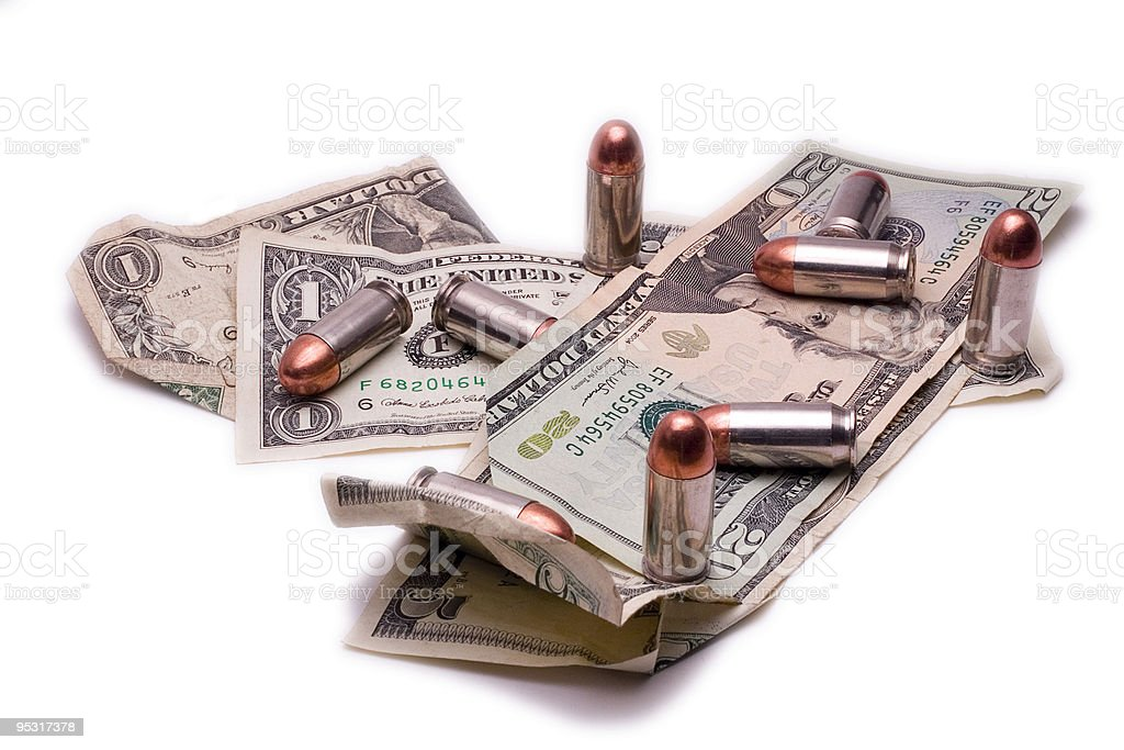 Bullets and bills royalty-free stock photo