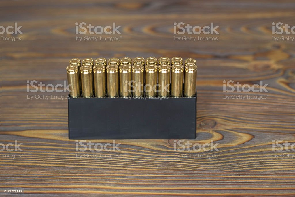 Bullets for hunting on the wood stock photo
