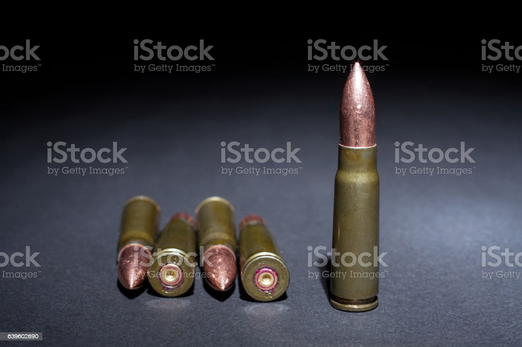 Bullets from AK47 Rifle Ammunition coseup on Black background. stock photo