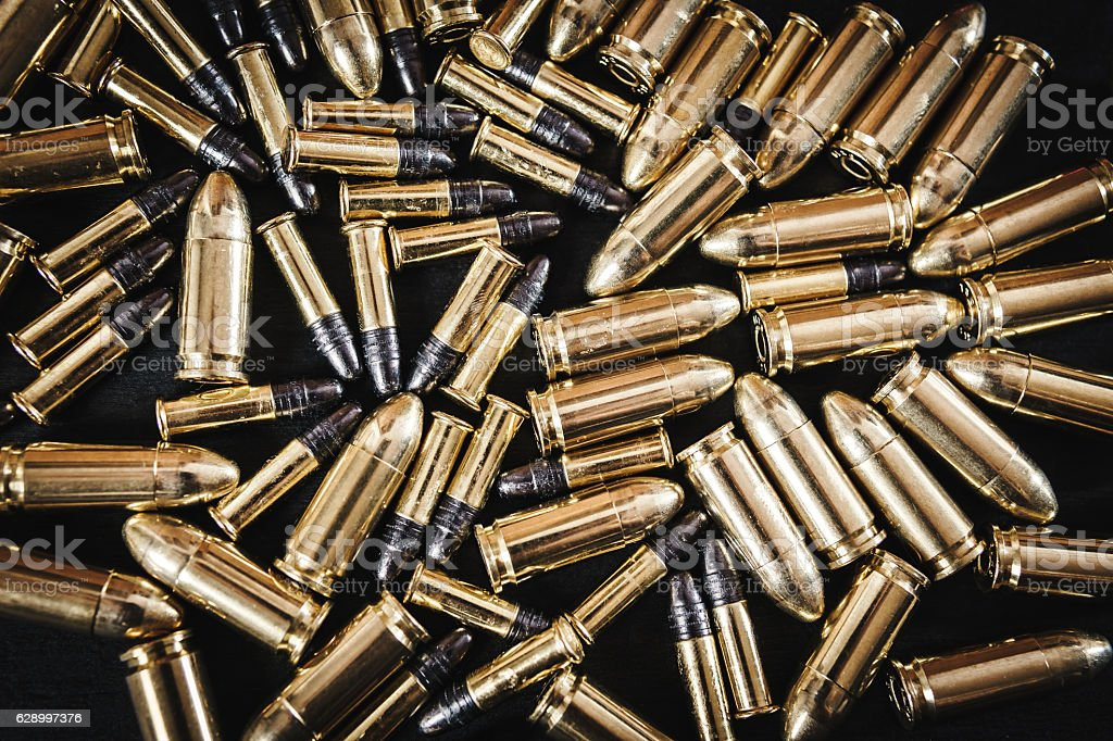 bullets from the gun on the table stock photo