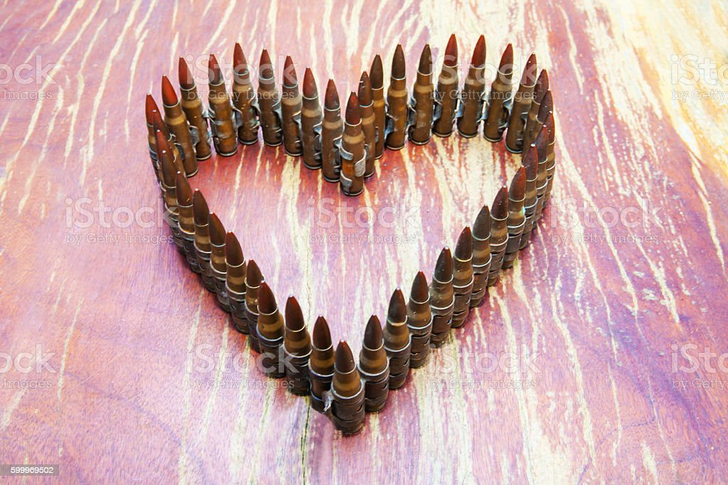 Bullets, heart stock photo