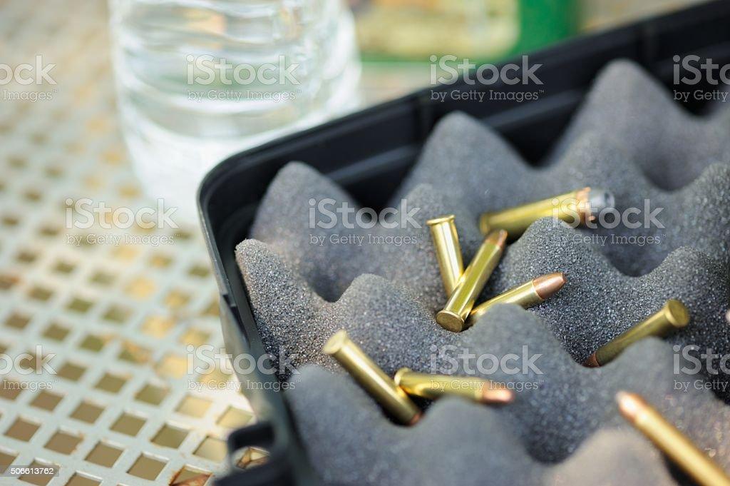 Bullets in gun case stock photo