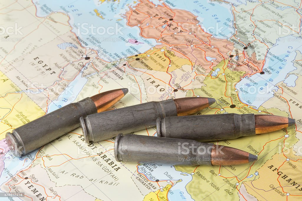 Bullets on the map of Middle East stock photo