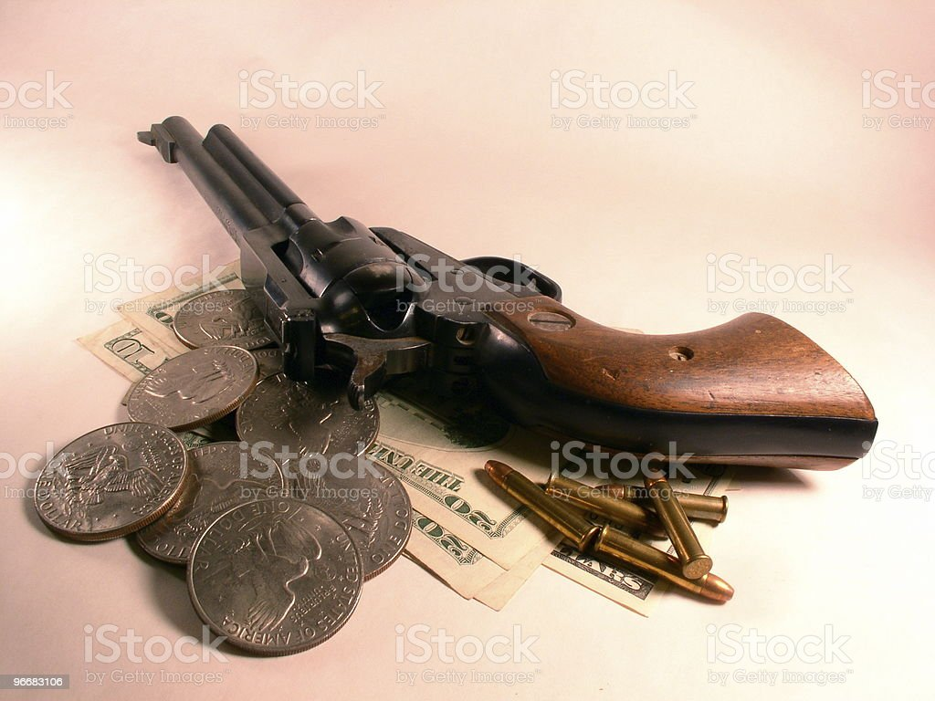 Bullets, silver dollars, and a revolver royalty-free stock photo