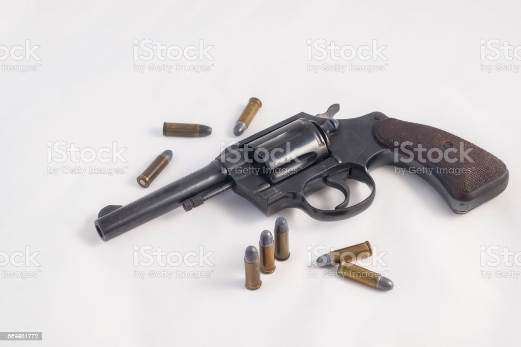 Bullets with the gun isolate background stock photo