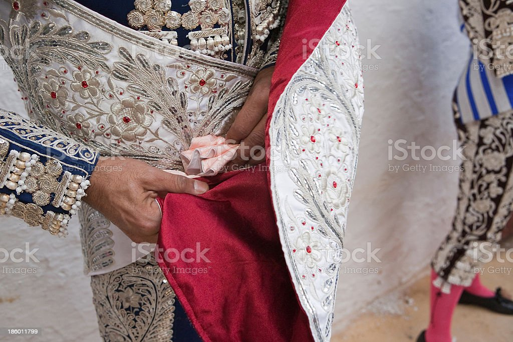 Bullfighter getting dressed for the paseillo or initial parade royalty-free stock photo