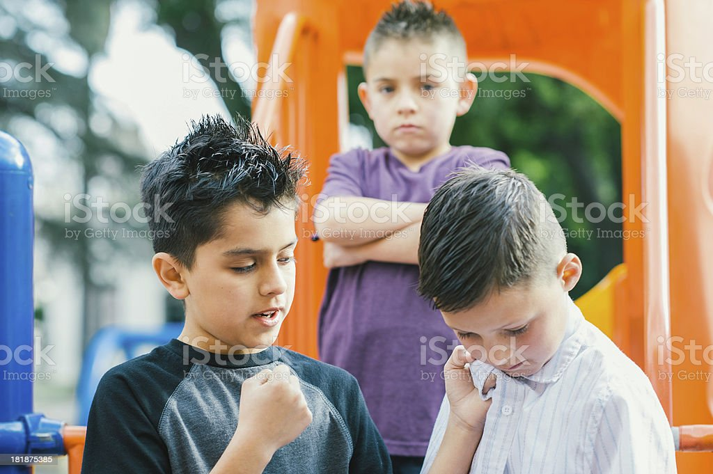 bullies about to punch boy royalty-free stock photo