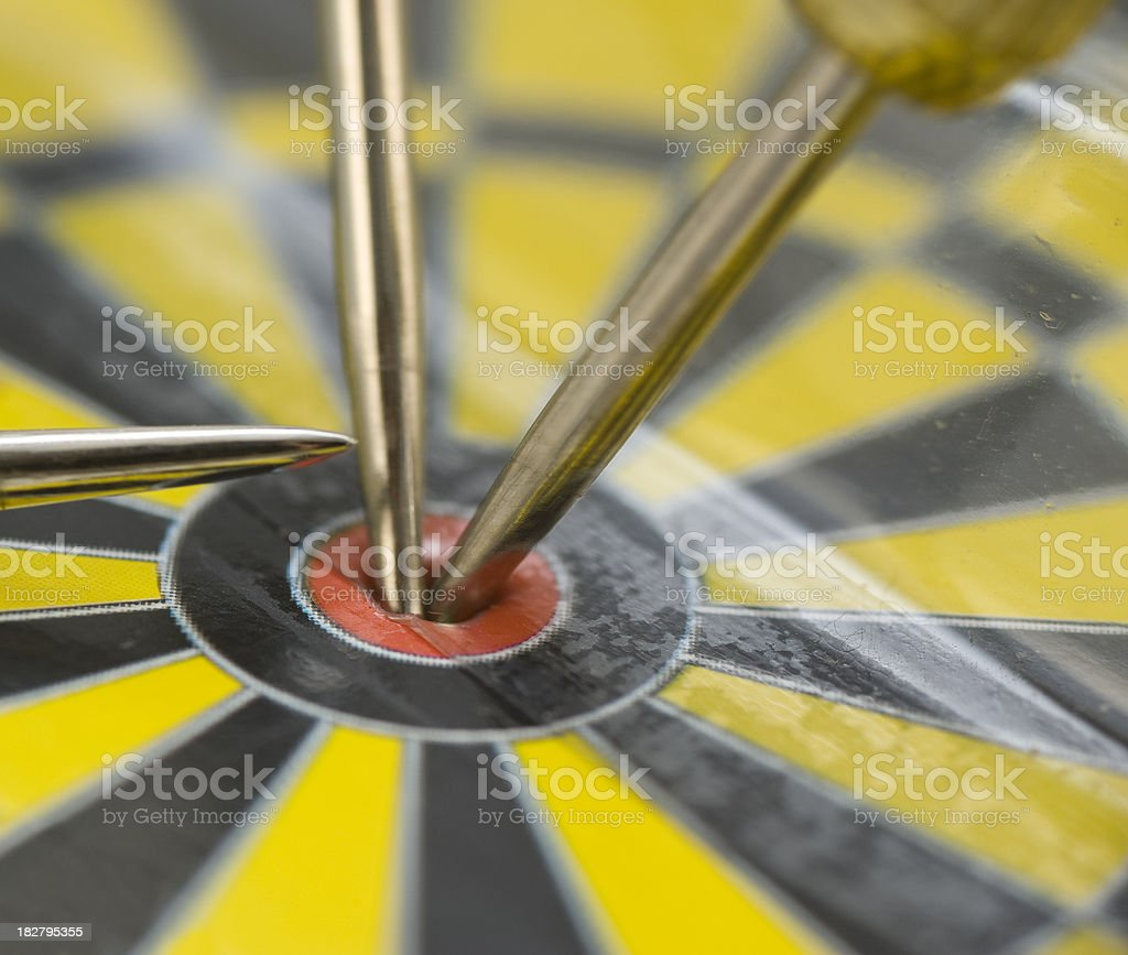 bulls eye on yellow dartboad macro shot stock photo