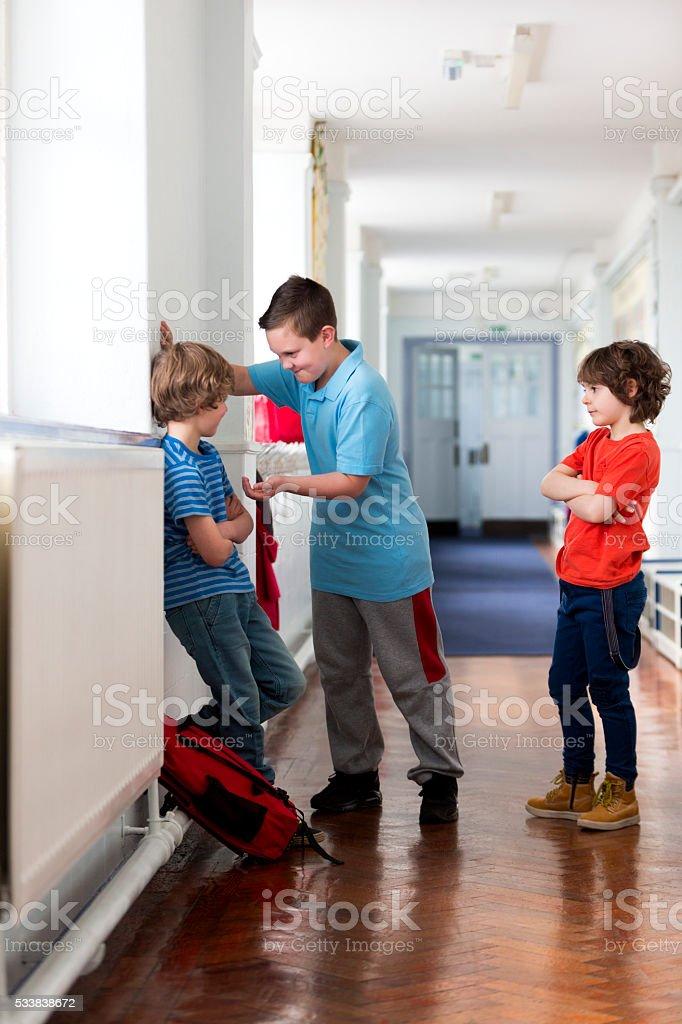 Bullying In The School Corridor stock photo